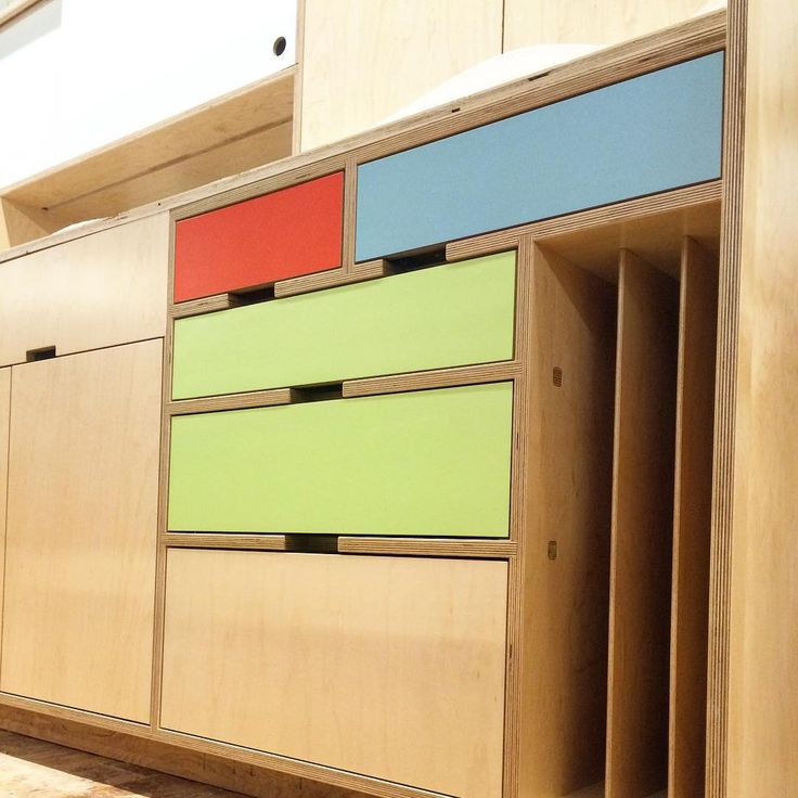 "vertical sheet pan or cutting board storage cubbies built into this colorful europly kitchen cabinet with exposed edges by Kerf Design. ""This time of year the colors really start to come out. This maple kitchen has a variety of color and functional details. #kerfdesign #weloveplywood…"""
