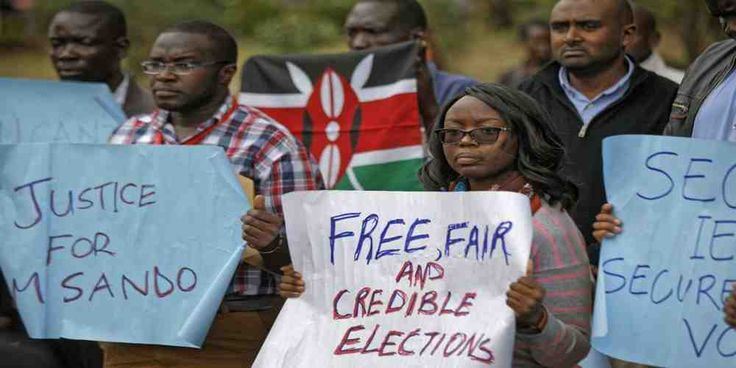 """Top News: """"KENYA POLITICS: Chris Msando Murdered! Kenyans Demanding Speedy Probe"""" - https://i0.wp.com/politicoscope.com/wp-content/uploads/2017/08/Members-of-civil-society-groups-protest-the-killing-of-electoral-commission-information-technology-manager-Christopher-Msando-at-a-demonstration-in-downtown-Nairobi-Kenya-News.jpg?fit=1000%2C500 - Chris Msando, the election board's head of information, communication and technology, was found murdered on Monday. He had been tortur"""