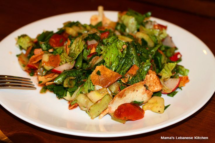 The Lebanese kitchen carries many crowns, and Fattoush salad is one of them. What distinguishes Fattoush are 2 main aspects: the number of greens and vegetables it carries, and the complex rich flavor that the pomegranate molasses and/or sumac spice engulf it with. Fattoush is the official Lebanese peasant salad, and farmers just throw in whatever