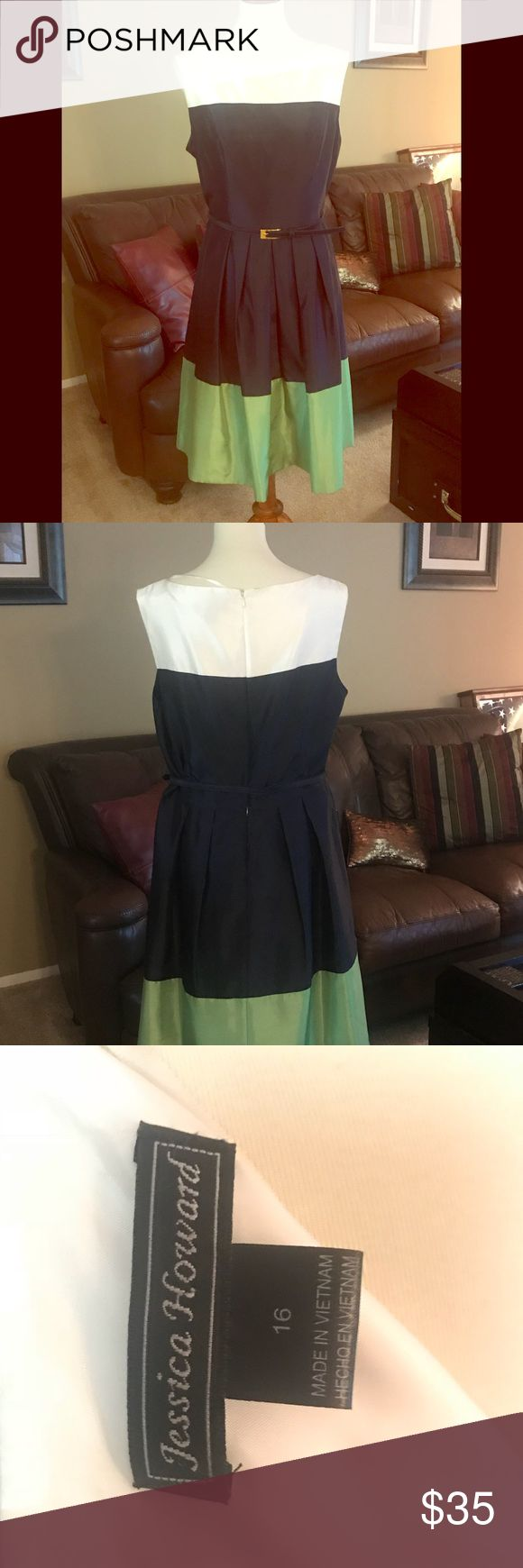 Dress Sleeveless color block dress has belted waist and fuller skirt. The chintz material and structure of this dress gives it a timeless look. Colors are white, navy blue and chartreuse.  NWOT, never worn, Smoke Free home. 35 Jessica Howard Dresses Midi