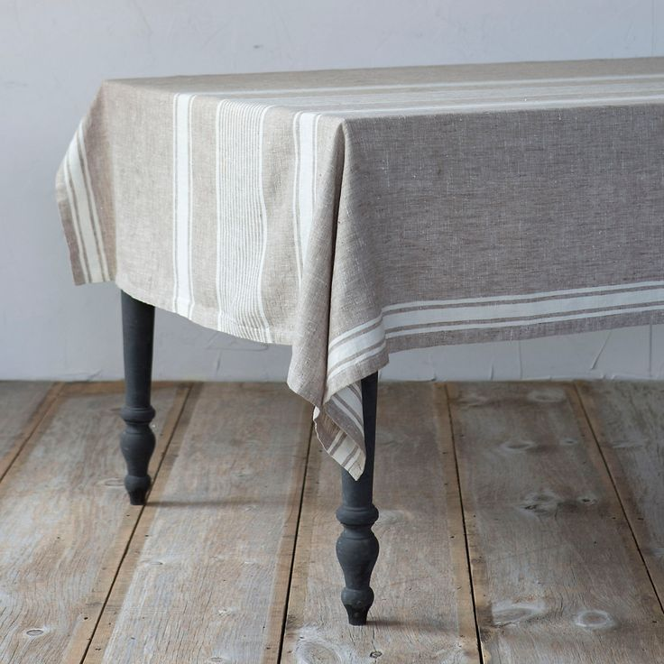"Edged with contrasting stripes, this classic tablecloth is handmade by a family-run linen mill.- Linen- Machine wash, line dry- Handmade in Lithuania52""W, 74""L"