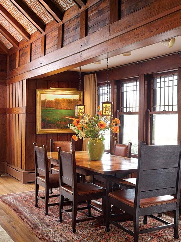 "The original dining room is actually a nook within the great living room. Pendant lamps are antique, as are the chairs, a Roycroft set of 12 that includes ""father's chair."""