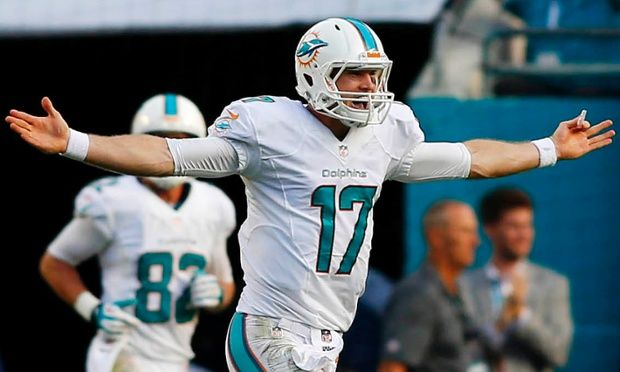Miami Dolphins quarterback Ryan Tannehill celebrates a fourth-quarter touchdown pass against the New England Patriots in week 15 of the NFL season.