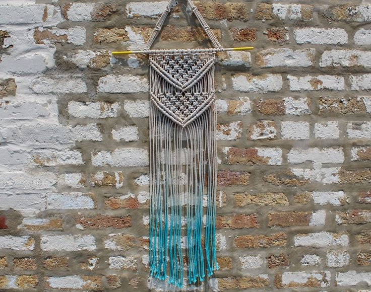 How to macrame a wall hanging with a pretty triangle design and optional dip-dyed ends. Illustrated steps to create a square knot included!