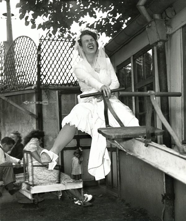 Robert Doisneau. 1946...Whoopsie - looks like the teeter totter beat her husband to the punch on their wedding day.  Never heard of losing your virginity to a board.