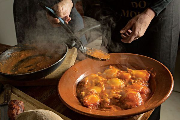 Portuguese home cook Conceição Louro of Estremoz infuses tomatoes with smoky bacon and sausage in this rich tomato soup served with poached eggs.