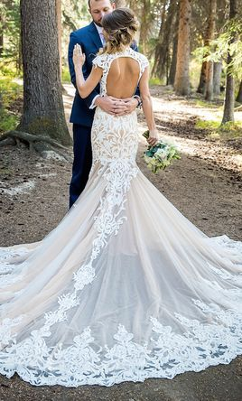 Heavenly lace on this Calla Blanche Lydia wedding dress