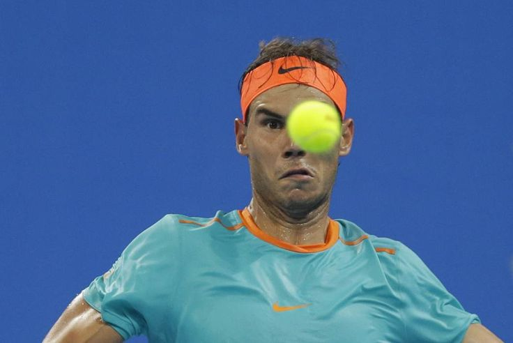 Rafael Nadal of Spain eyes the ball as he prepares to hit a return during his men's quarter-final match against Martin Klizan of Slovakia at the China Open tennis tournament in Beijing, October 3, 2014. (REUTERS/Jason Lee)