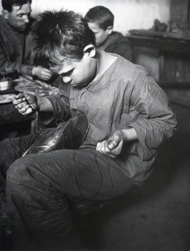 A street kid learns shoe making, 1929.