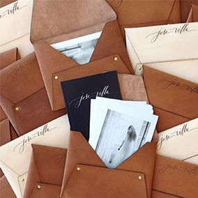 Jose Villa Leather Pouches by Pitbulls and Posies with Anne Robin Calligraphy. Photo by Jose Villa.