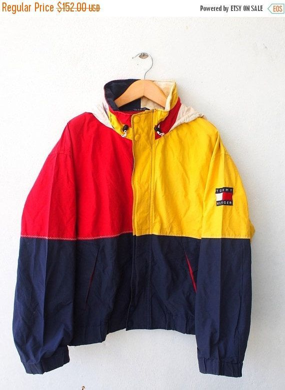 """TOMMY Hilfiger Color Block Vintage 90's Hip Hop Yellow Red Windbreaker Hoodie Jacket Coat Size XL Tag reads: XL (check measurements below) Measurements: Width (armpit to armpit): 27"""" Length (shoulder to end of garment): 28"""" All measurements are taken with the garment flat on the ground. Condition: Good Condition.Have a stains at hoodie and neck,please refer pictures."""