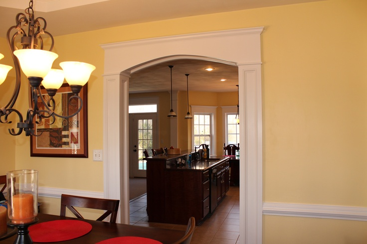 Arch molding between my kitchen and dining room with crown for Crown molding ideas dining room