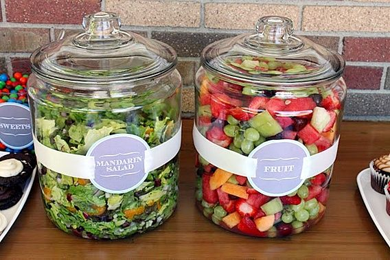 I love this idea for a party because it keeps the food covered!  You could  put a spoon rest in front of each jar for easy serving.