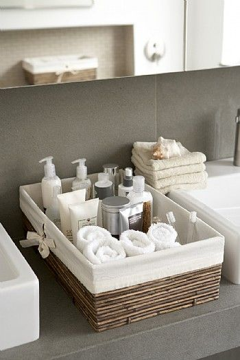 "Keeping a basket filled with ""necessities"" is the perfect way to let your guests know that you've got them covered!  :)"