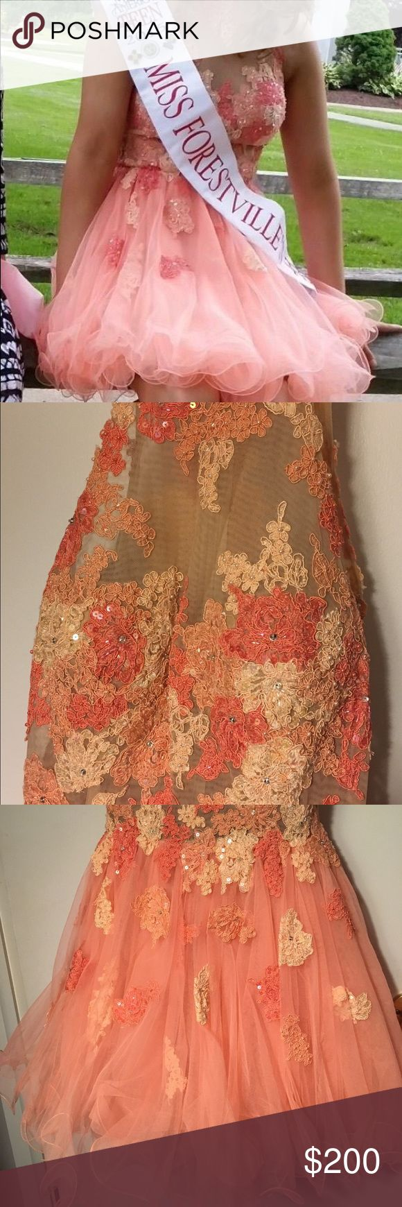 MacDuggal Sample Peach & Nude Cocktail Dress 4 You will be one of a kind with this gorgeous MacDuggal sample cocktail dress, size 4.  The bodice has a nude panel with floral embellishments accented with sequins & beads. The embellishments extent down into the fluffy skirt. There is a satiny underskirt with several layers of tulle that is curled at the hem to make it full.  There are cups inside the top to hold everything in place! Back has a hook and zipper that work just fine. Worn once for…