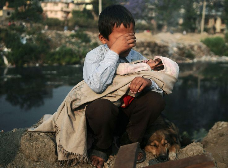 A boy in Nepal being evicted from his home