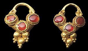 Pair of gold and garnets earrings. Roman, Balkan region, circa 2nd-3rd century AD. Each with hollow rounded crescent.