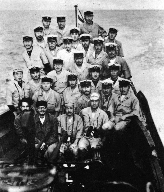 The crew of the Imperial Japanese Navy submarine I-29 before disembarking in Sabang, Sumatra, then under Japanese occupation, on 6 May 1943. Earlier, the submarine had rendezvoused with the Kriegsmarine German submarine U-180, 300 sm southeast of Madagascar in the Indian Ocean. During the rendezvous, Indian nationalist Subhas Chandra Bose, shown here sitting on the left in the front row (with glasses and hat), was transferred. 28 April 1943. Pin it by GUSTAVO BUESO-JACQUIER