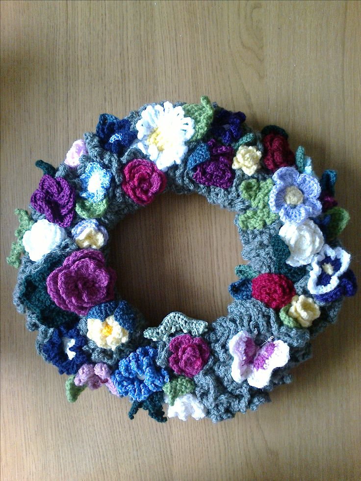 I crocheted round a coat hanger three times, increasing the number of stitches each time, then decorated with crocheted flowers and caterpillar