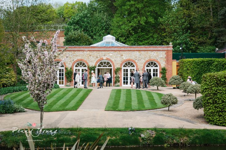Spring wedding at The Orangery in Maidstone Kent. Outdoor gazebo ceremony. Photography by Penny Young Photography.