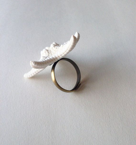 The Mermaid's Starfish Ring  Natural White by dreamsbythesea, $25.00  (What to do with those little things u have picked up along the way..)