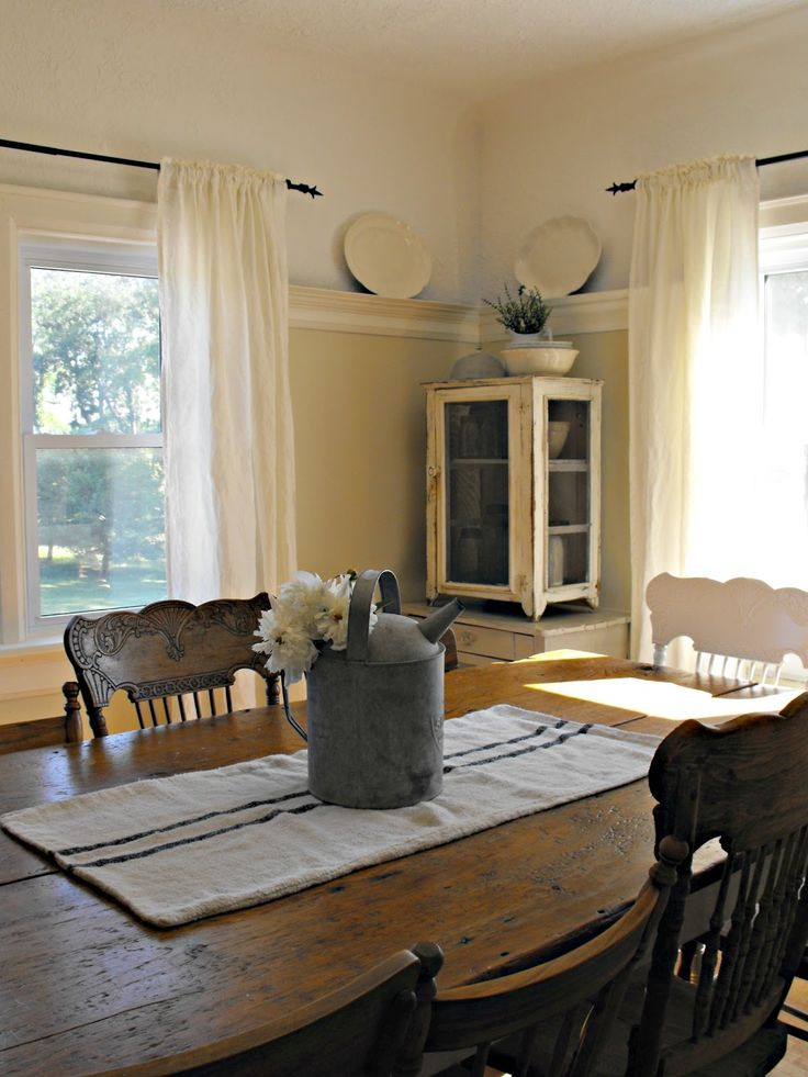 Showcases Raised Panel Walls Barn Wood Floor Exposed Beamed Ceiling And A Simple Style For Moulding Trim Like In This Farmhouse Dining Room