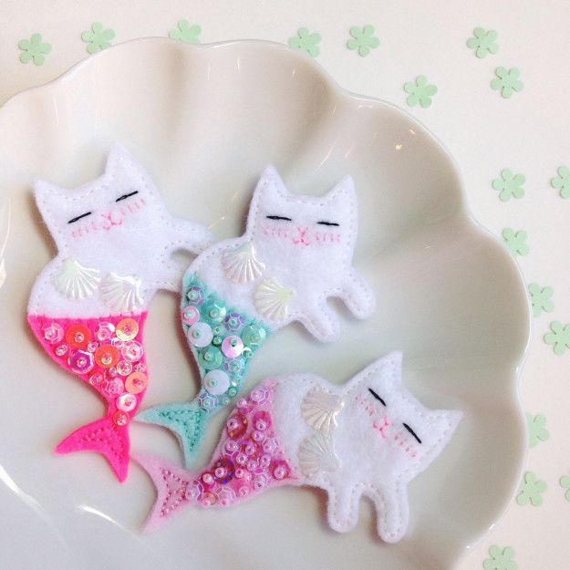 "Handmade ""meowmaid"" brooches."
