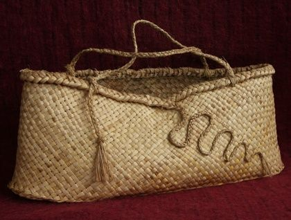 Large flax kete Perfect to take shopping, my daughter takes her's to the farmers market every week. Strong and versatile Made from organically grown flax with detailing on front Dimensions (Approx): 65 cm (long) x 25 cm (high) x 11 cm (wide at base- but there is a lot of give in the widt...