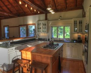 Camelot Farm dates back to 1704 and features an interior that is as spectacular as the surrounding Tyringham valley. The six-bedroom home has large and open living spaces gleaming with wood, from the floors, walls and large, exposed beams. There is a large stone fireplace and a porch to capture the eastern and western horizons. Sited on 158 acres, it offers eight barns and outbuildings including the timber-framed dairy barn that was built in 1891. Listed for $1.5 million by Brockman Real…