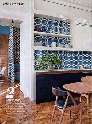 The kitchen in Where I'd Stay's St Sulpice features Popham Design tiles, vintage Danish furniture, Areti lighting, and 350 year old Versailles parquet floors, as featured in Germany's Schøner Wohnen Magazine (October 2015)