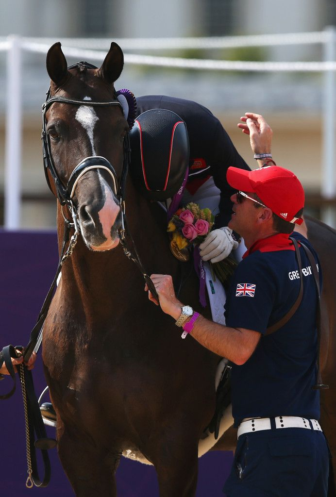 Charlotte Dujardin of Great Britain riding Valegro celebrates with her gold medal during the medal ceremony following the Individual Dressage on Day 13 of the London 2012 Olympic Games at Greenwich Park on August 9, 2012 in London, England.