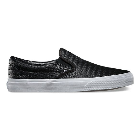The Embossed Check Classic Slip-on has a low profile, embossed checkerboard  leather upper