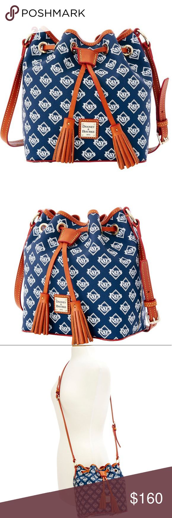 "💕👜Just in Dooney&Bourke MLB Rays Kendall👜💕 Let's go, Rays! Shop officially licensed bags and support your team in style. A scaled down version of the classic Kendall. The Kendall Crossbody is sporty enough to carry on weekends, and stylish enough to take out at night. One inside zip pocket. Cell phone pocket. Inside key hook. Adjustable strap. Strap drop length 25"". Lined. Feet. Drawstring. Feet. Tampa Bay Rays. Check out my closet for more amazing brand new items.👍👜😊💕💕💕 Dooney…"