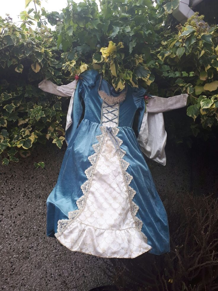 A dress up costume long grown out of. Hung with an old stretched out wire hanger, ghostly!