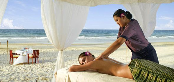Island spa massage on the beach.