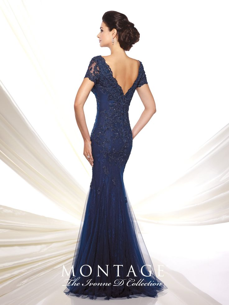 Lace and tulle slim trumpet gown with lace illusion short sleeves, front and back scalloped V-necklines, dropped waist, inset sweep train. Sizes: 4 – 20, 16W – 26W Colors: Navy Blue, Aqua, Plum
