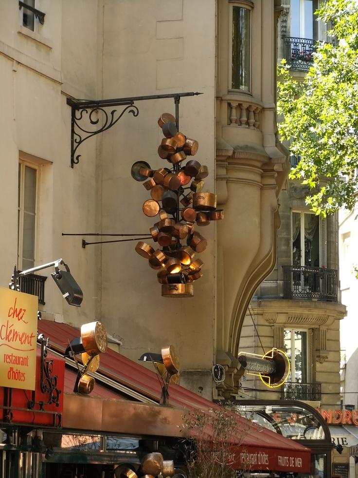 Copper pans at a restaurant somewhere in Paris, France