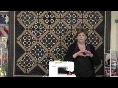 Jenny Doan demonstrates how to make the Tavern Blues Civil War Quilt created by Bonnie Blue Quilts using a quilt kit.