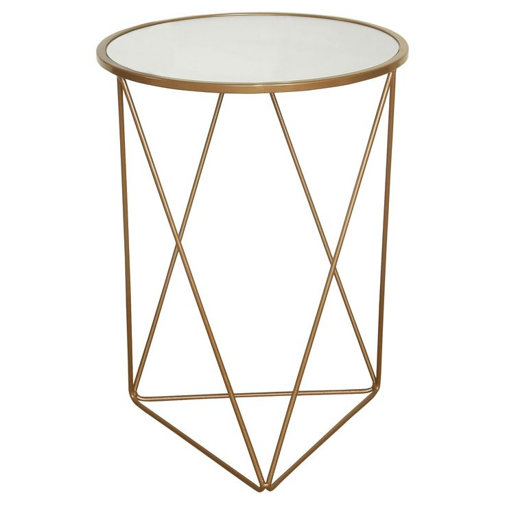 • Circular glass table top<br>• Gold metal frame <br>• Perfect size for end table or night stand<br><br>The Accent Table Gold – HomePop will bring a modern touch to your living space with its diamond wire frame and circular shape. This eye catching gold end table will turn heads.