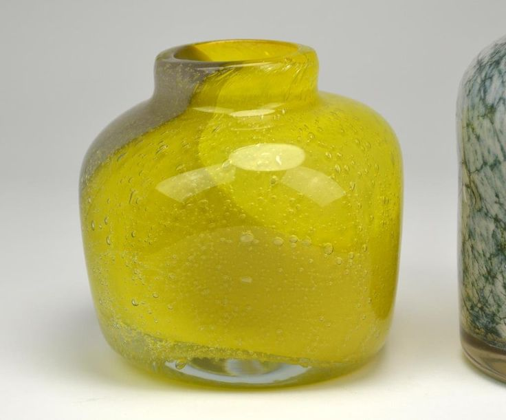 Squared yellow vase with paper label Randsfjordglass by Hanna Hellum and a moss agate decorated cased vase by Benny Motzfeldt for Plus Glasshyte. H 16 cm. (6 1/4 in.)