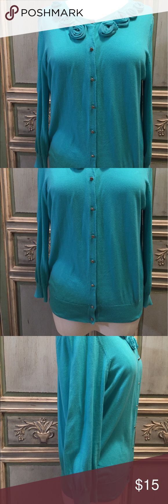 Turquoise Cardigan with Rose Floral Decoration Ann Taylor LOFT Turquoise Cardigan with Rose Floral Decoration around the neckline.  Silver Buttons.  Size: Large  Material Details: 100% Cotton  Care Details:  See photo of tag LOFT Sweaters Cardigans