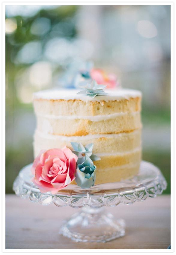 White layer cake with paper flower cake topper