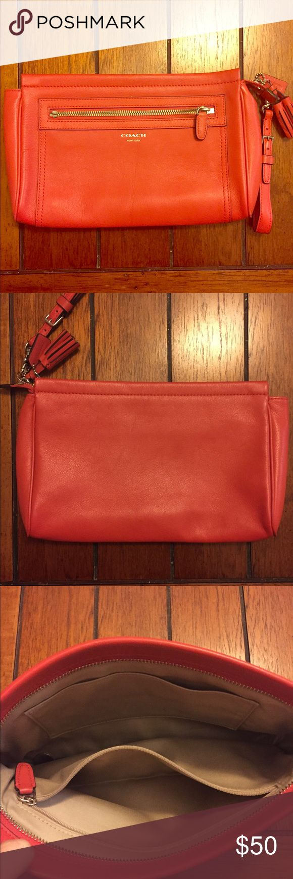Coach clutch Red Coach clutch with tan interior. It has only been worn a number of times and no markings or blemishes on the exterior or interior. It is the perfect clutch for spring and summer! Coach Bags Clutches & Wristlets