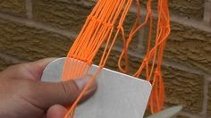 A close up of how to tie the netting knot when sewing the main net
