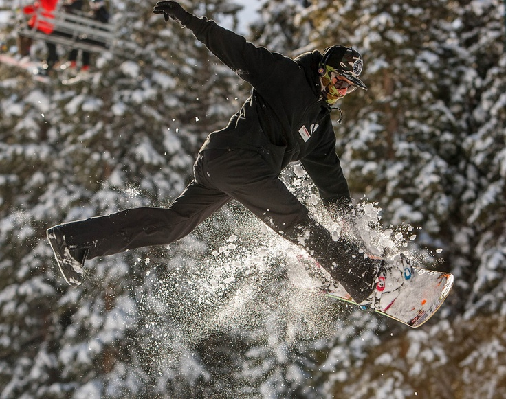 A snowboarder jumps off a rail on opening day at Brighton Ski Resort. (Trent Nelson     The Salt Lake Tribune)