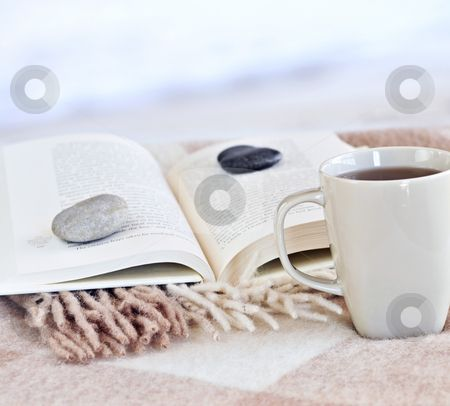 A book, some coffee, and a few stones.