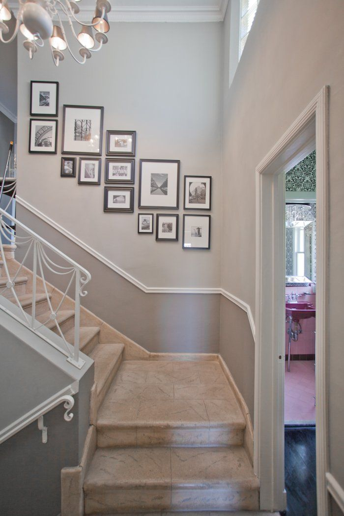 such a great stairway. great railings and gallery wall.