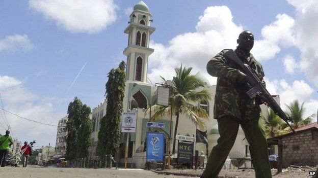 churches in Mombasa Kenya | Kenyan policeman patrols past the Masjid Musa Mosque in Mombasa, Kenya ...