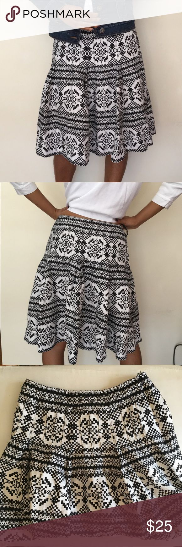 """Silk Nine West Black and White Midi Skirt Very cute Nine West Midi skirt perfect for spring! It's lightweight with a nice pattern in black and white. Size 4. Barely worn. No tears or stains. 70% silk, 30% linen.   Waist flat: 14"""" Length: 21""""  No trades please, offers welcome. Let me know if you have any questions 😊 Nine West Skirts Midi"""