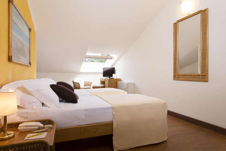Essential and decorous, all Classic rooms feature bathroom with shower–hydromassage (some with tub), hair dryer, telephone, satellite television, safe, minibar, air-conditioning and wireless network (all with dormer windows).